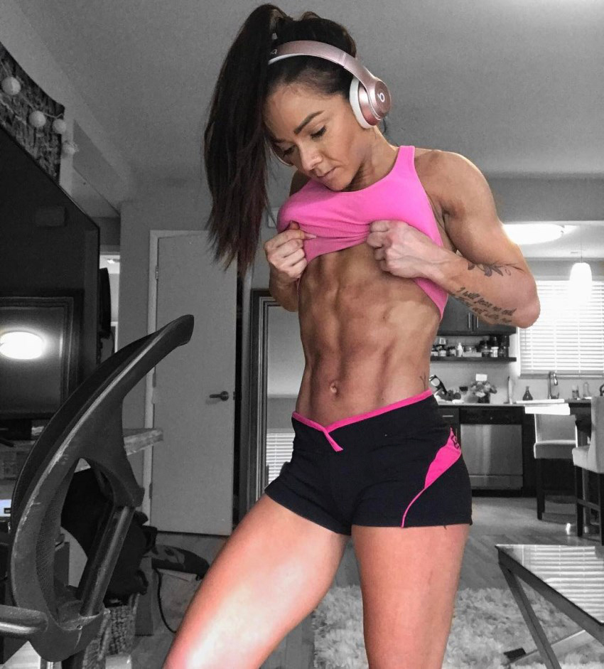 Caryn Nicole Paolini showing her ripped abs for the camera