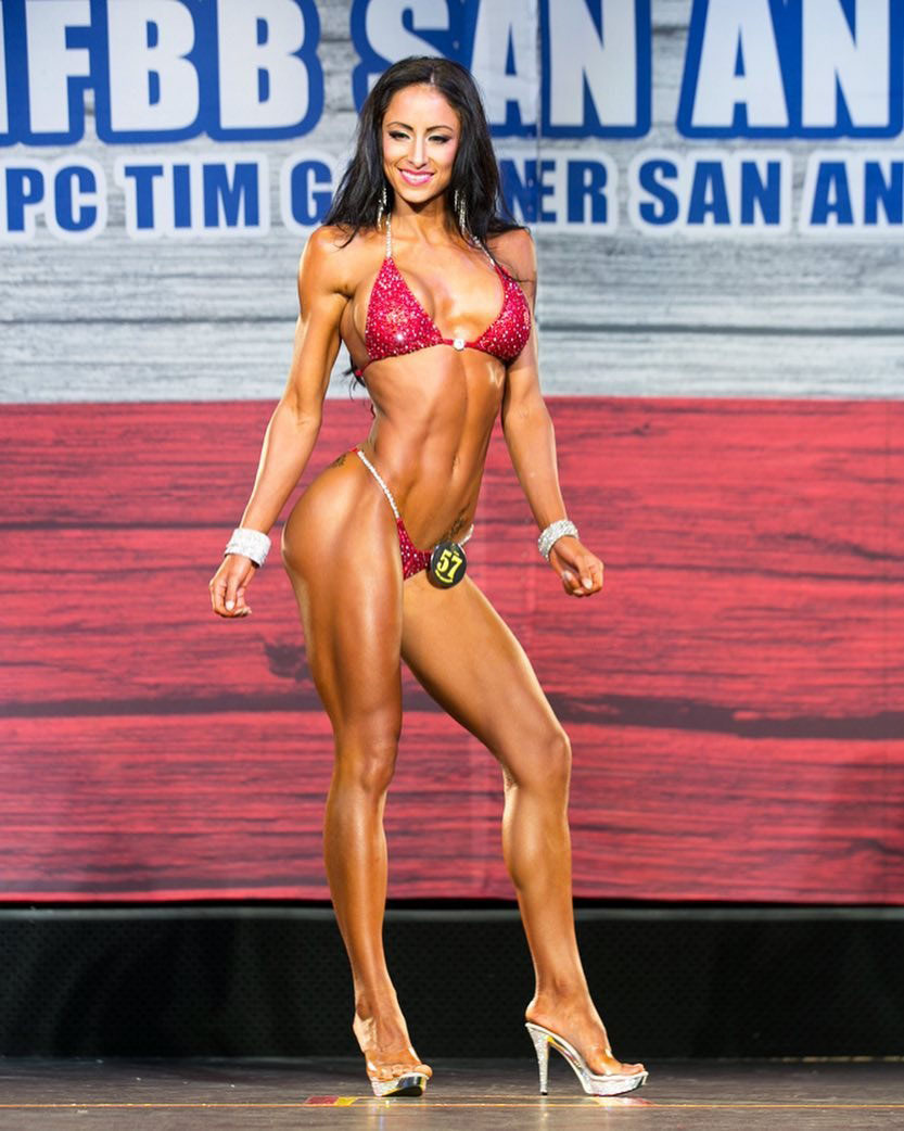 Casey Samsel posing on the bodybuilding stage.