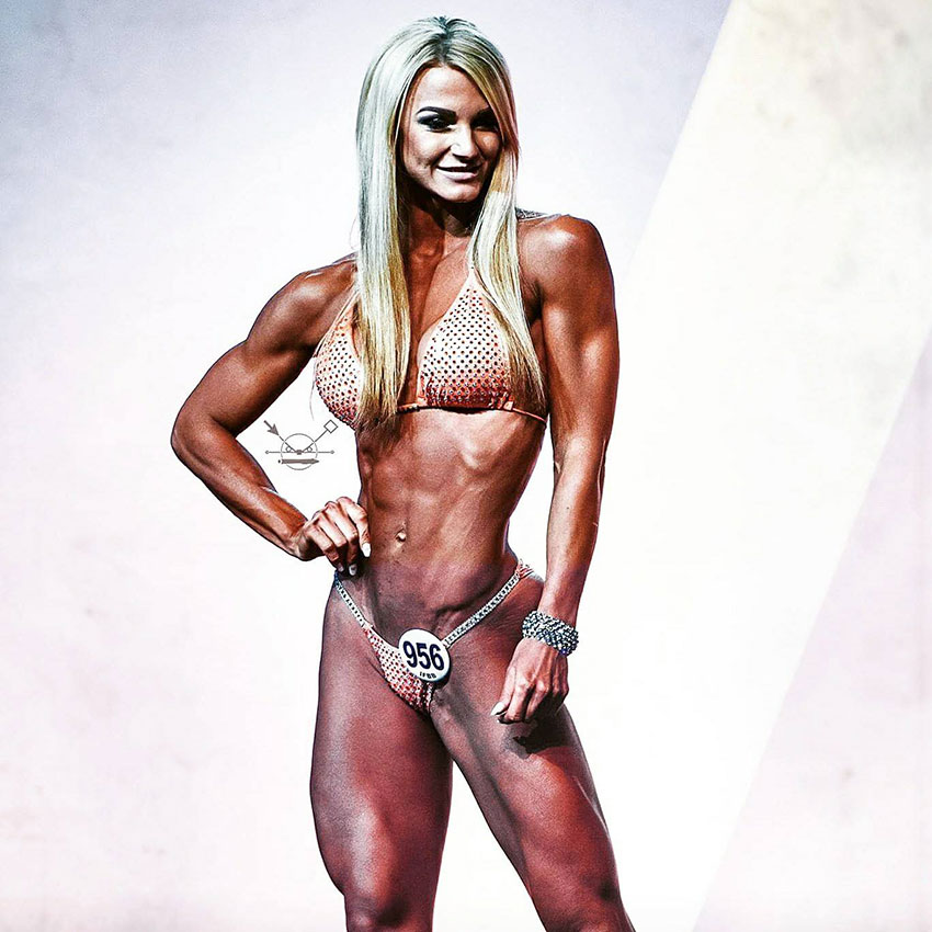 Catharina Wahl posing on the bodybuilding stage.