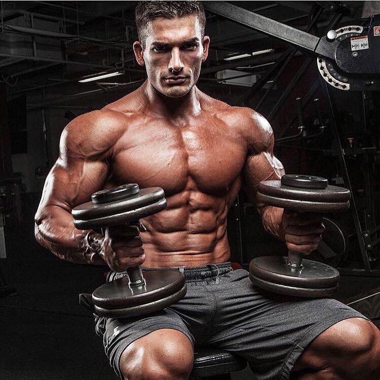 Chase Savoie holding dumbbells in a photo shoot.