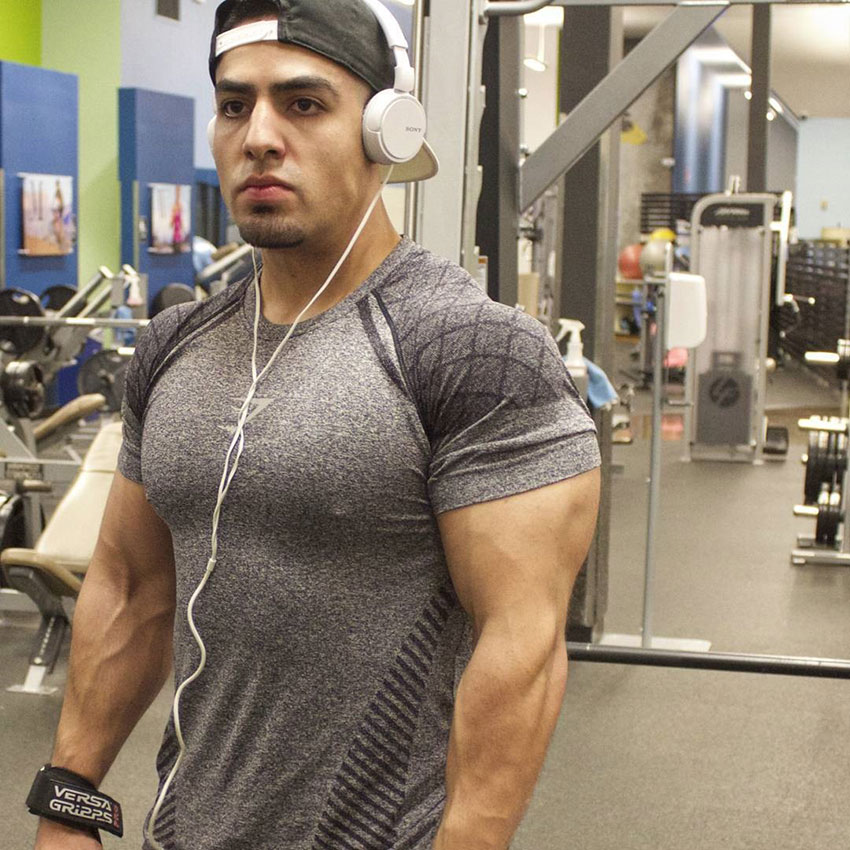 Chris Lavado posing in the gym.