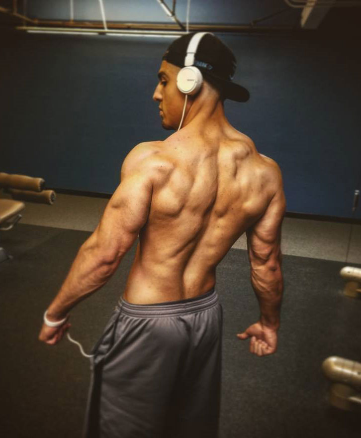 Chris Lavado showing off his back muscles.