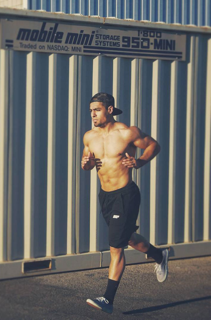 Chris Lavado running in a photo shoot.