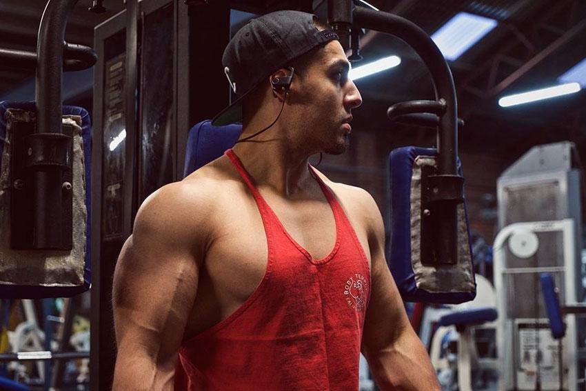Chris Lavado posing in the gym.