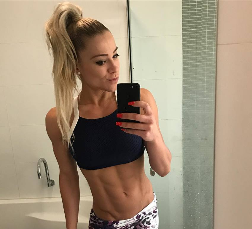 Christine Ray taking a selfie of her lean midsection