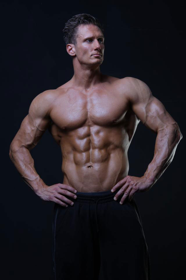 Dave Cunningham showing off his ripped abs in a photo shoot.