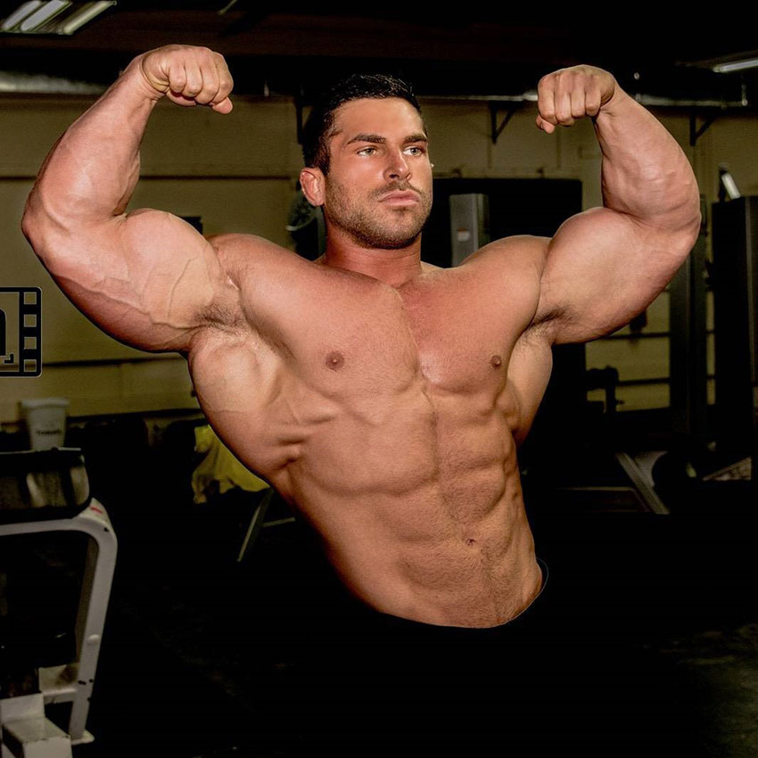 Derek Lunsford flexing his biceps.