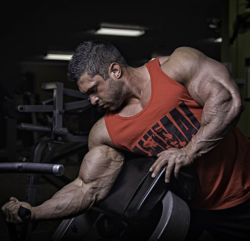 Derek Lunsford performing one arm concentration curls.