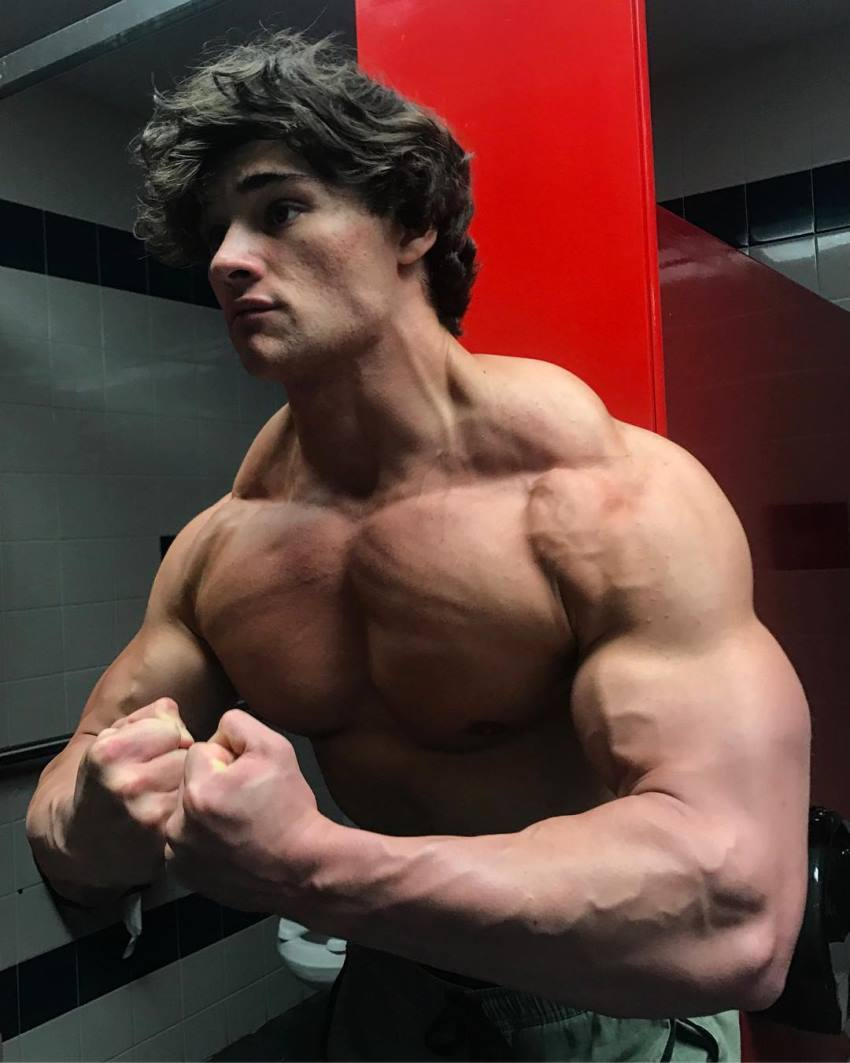 Dylan McKenna doing a most muscular pose, looking big and lean