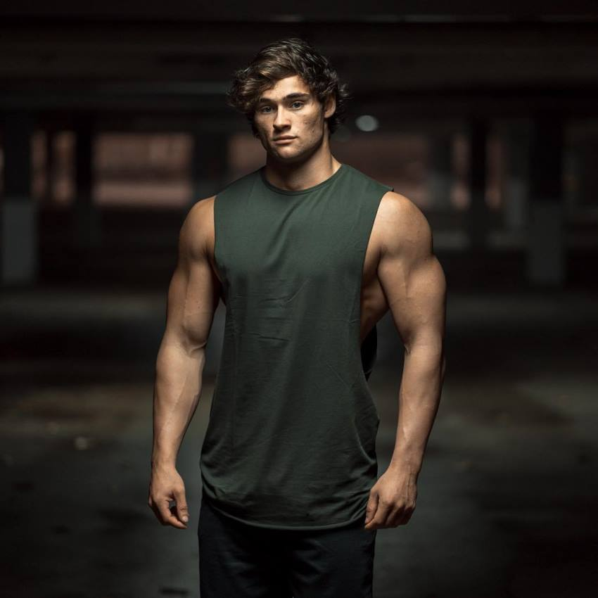 Dylan McKenna posing for the camera, wearing dark green tank top
