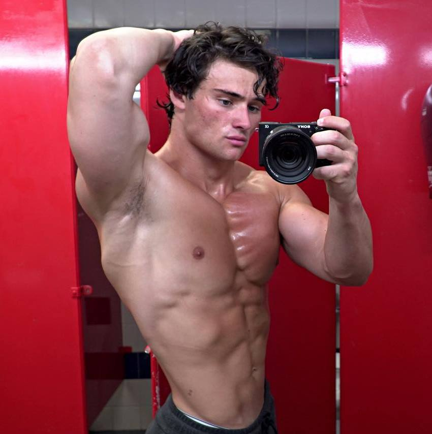 Dylan McKenna taking a shirtless selfie, looking muscular and lean