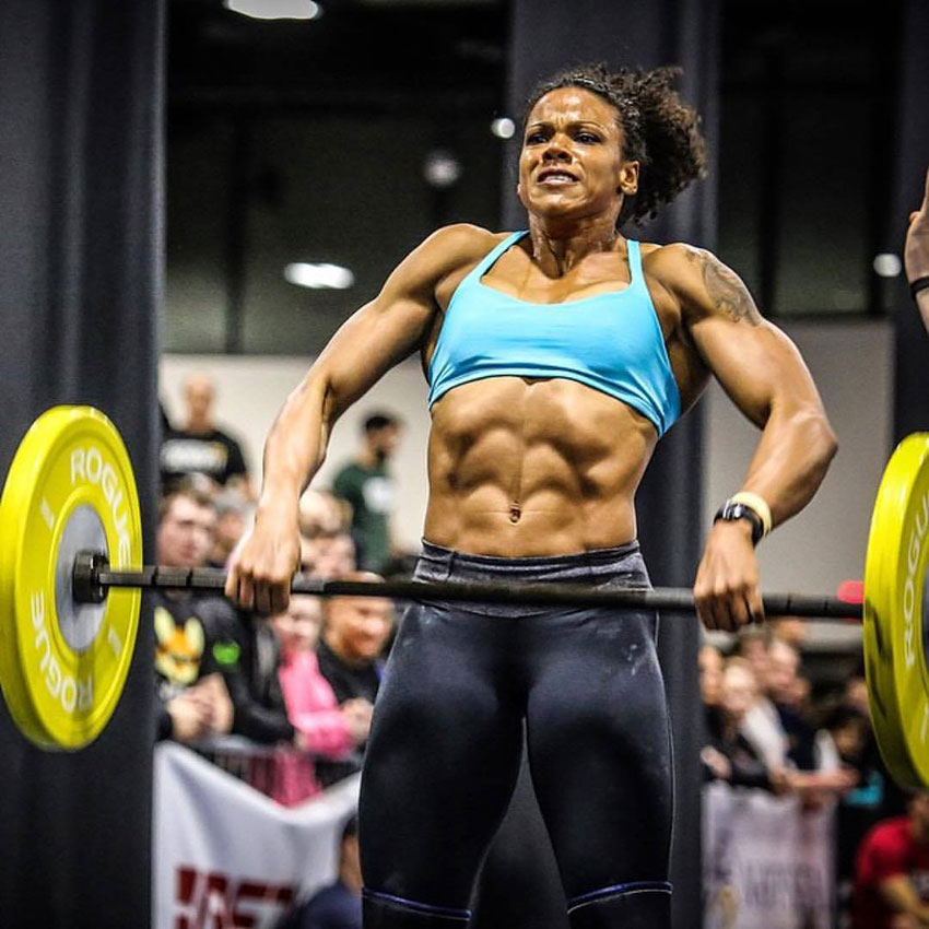 Elizabeth Akinwale performing an Olympic lift.