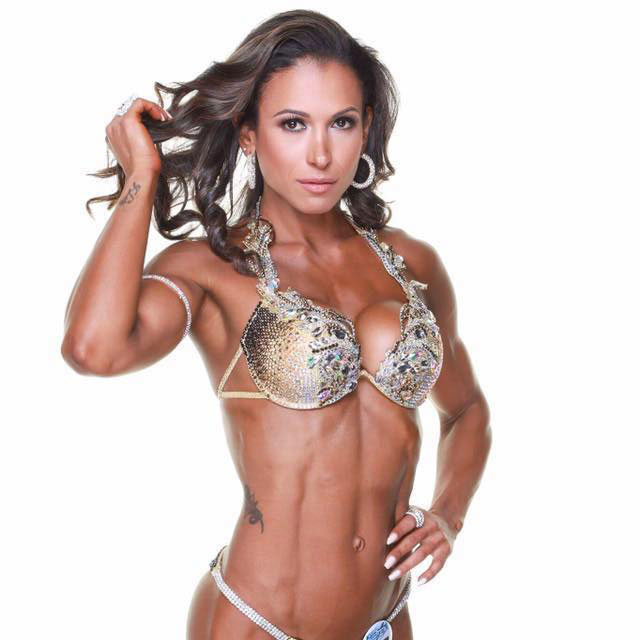 Flavs Basile showing off her physique in a competition bikini.
