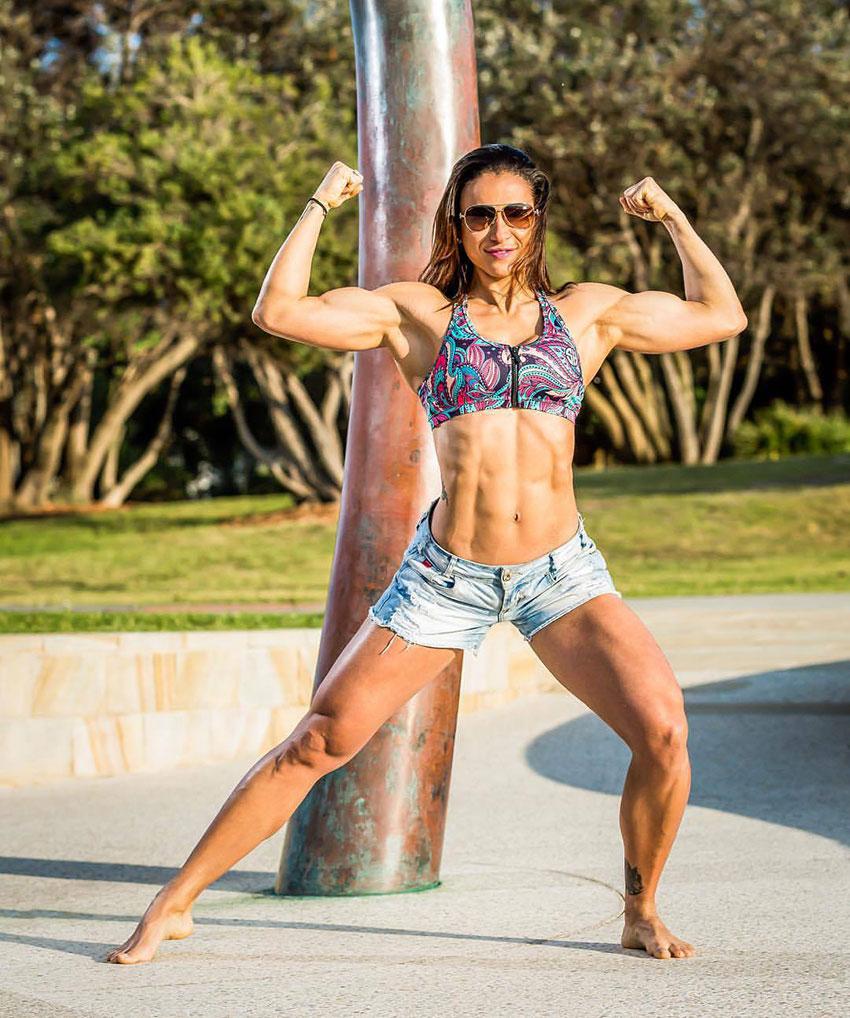 Flavs Basile flexing her biceps.