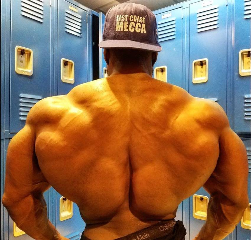 George Peterson showing off his massive and muscular back