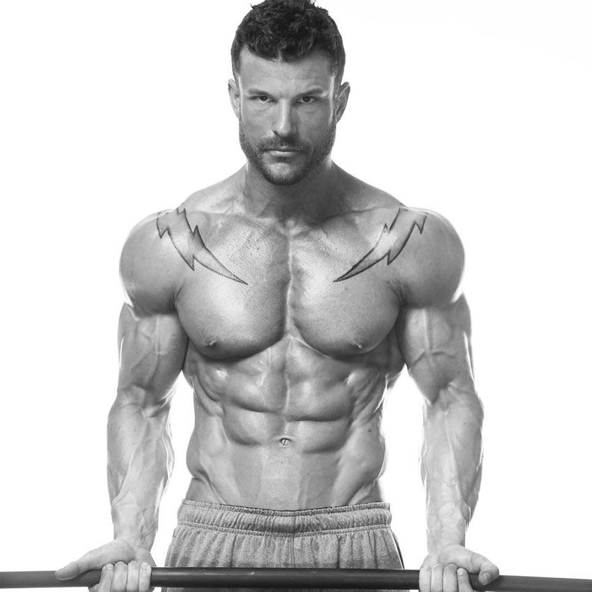 James Hurst holding a barbell in a photo shoot.