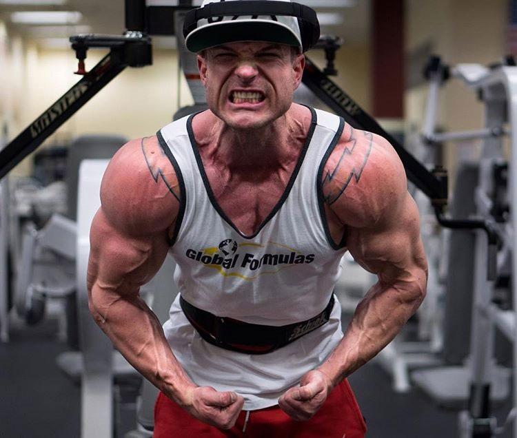 James Hurst flexing his biceps.