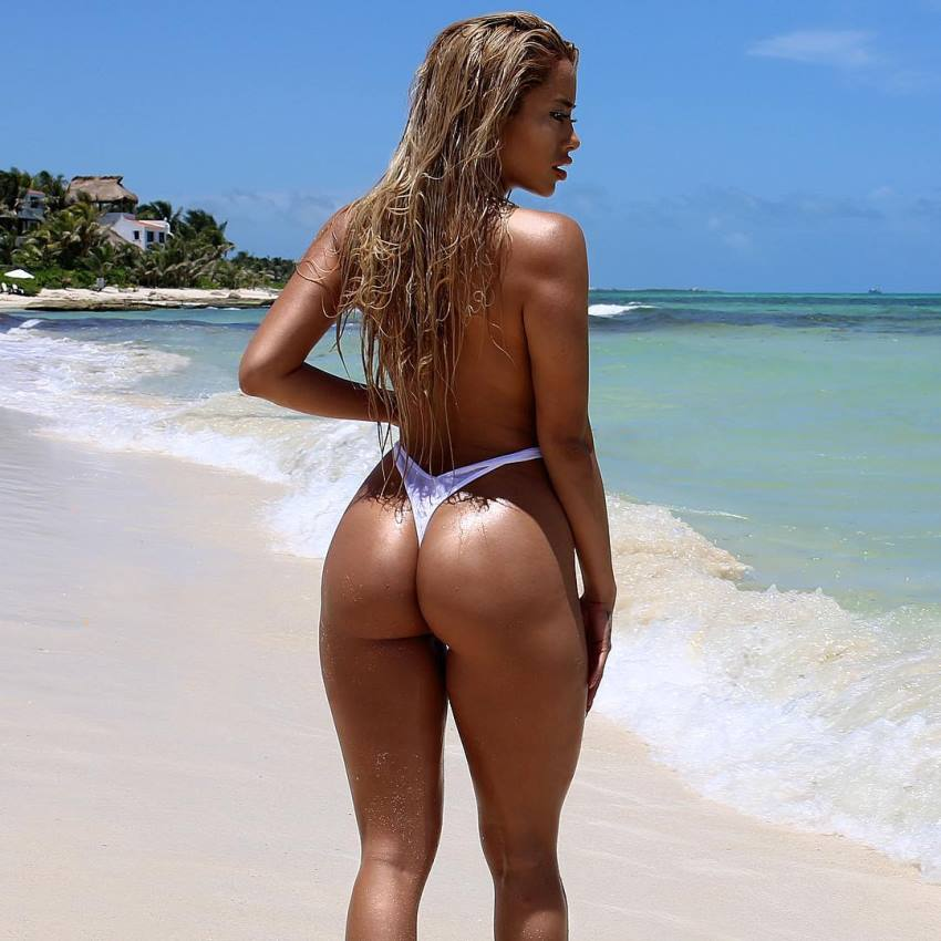 Jasmine Chiquito on the shore, her glutes and legs looking curvy and fit