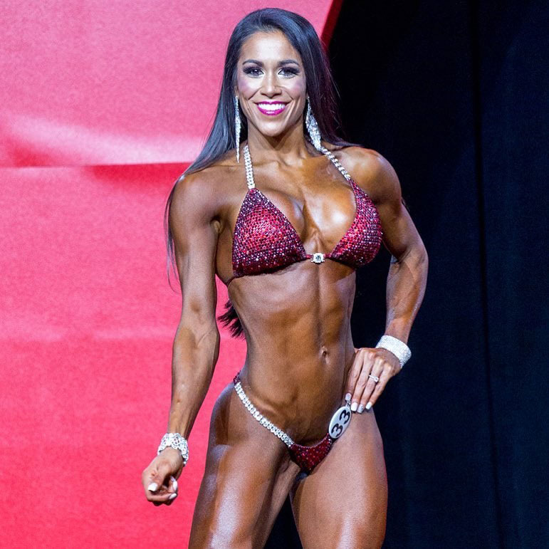 Jennifer Ronzitti posing on stage at a competition.