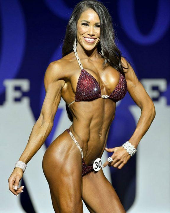 Jennifer Ronzitti posing on stage at a competition.