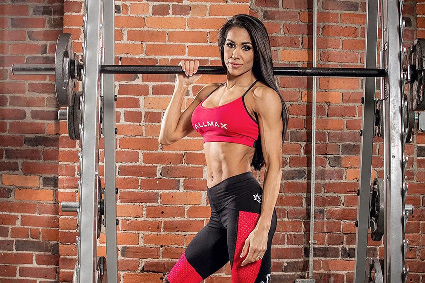Jennifer Ronzitti holding onto a barbell in a photo shoot.