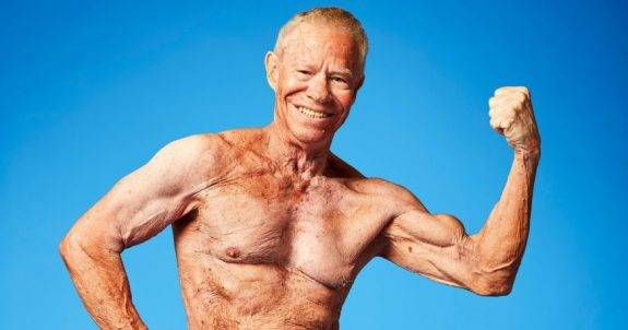 Jim Arrington flexing shirtless for the photo shoot