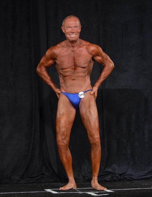 Jim Arrington flexing on the bodybuilding stage