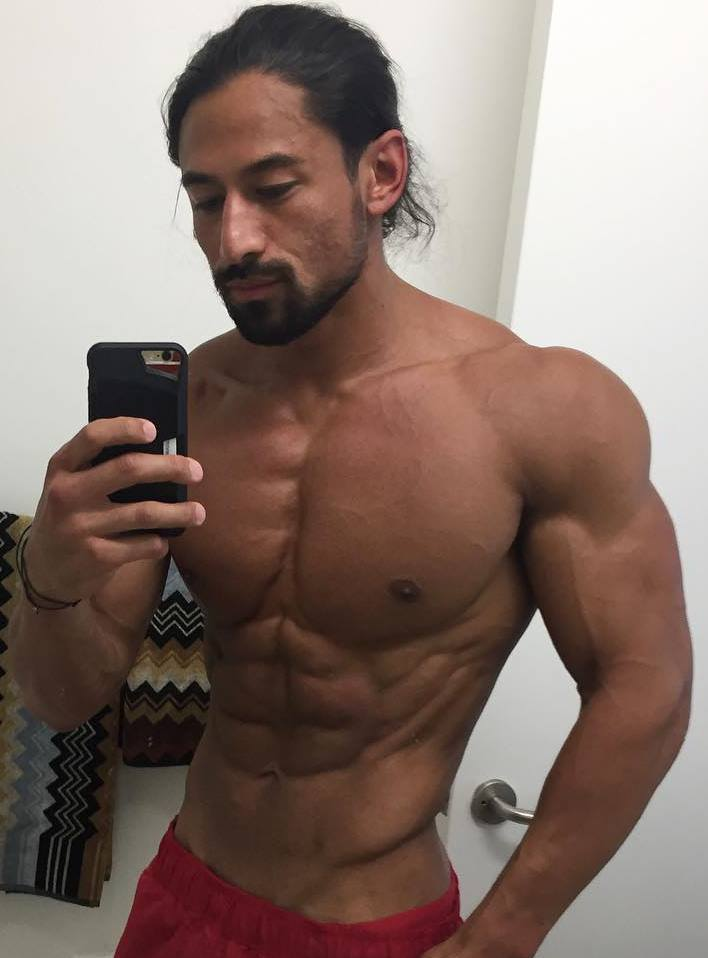 Justin Gonzales taking a selfie of his ripped upper body