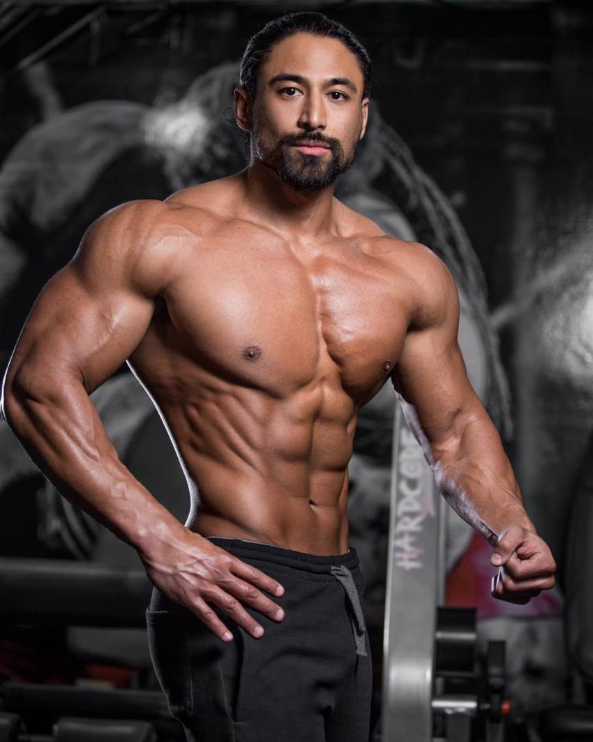 Justin Gonzales showcasting his ripped upper body for the photo