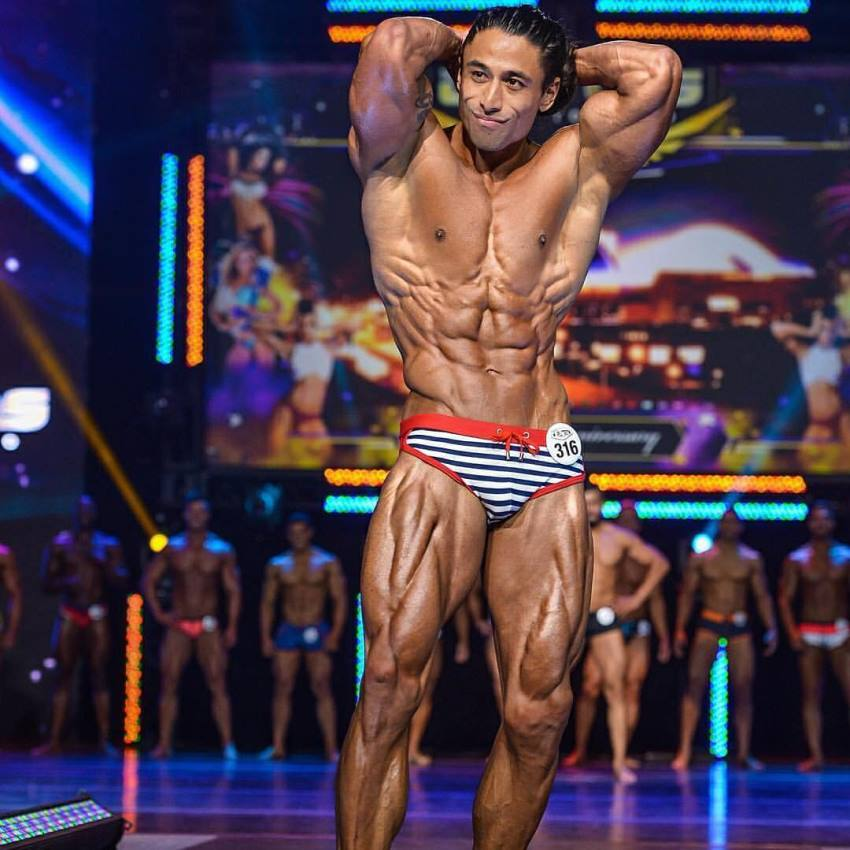 Justin Gonzales competing on the WBFF Fitness Model stage