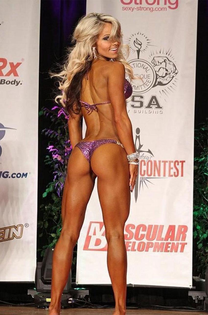 Justine Munro posing in a bikini competition.