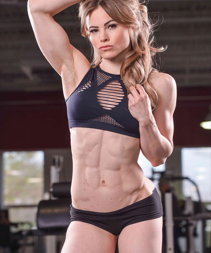 Justine Munro showing off her sculpted abs.