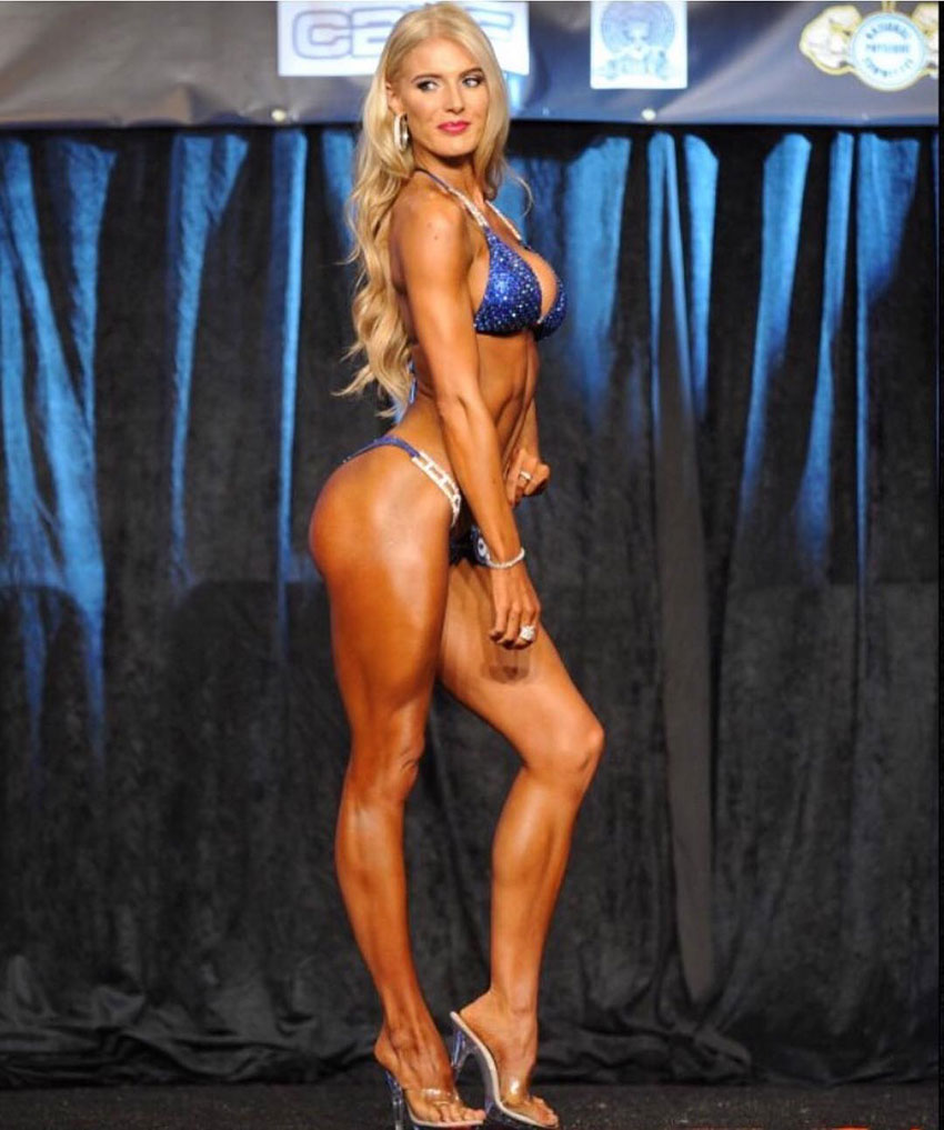 Katie Miller posing on stage.