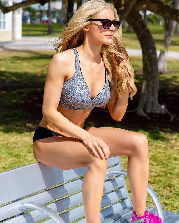 Katie Miller sat on a bench in a photo shoot.