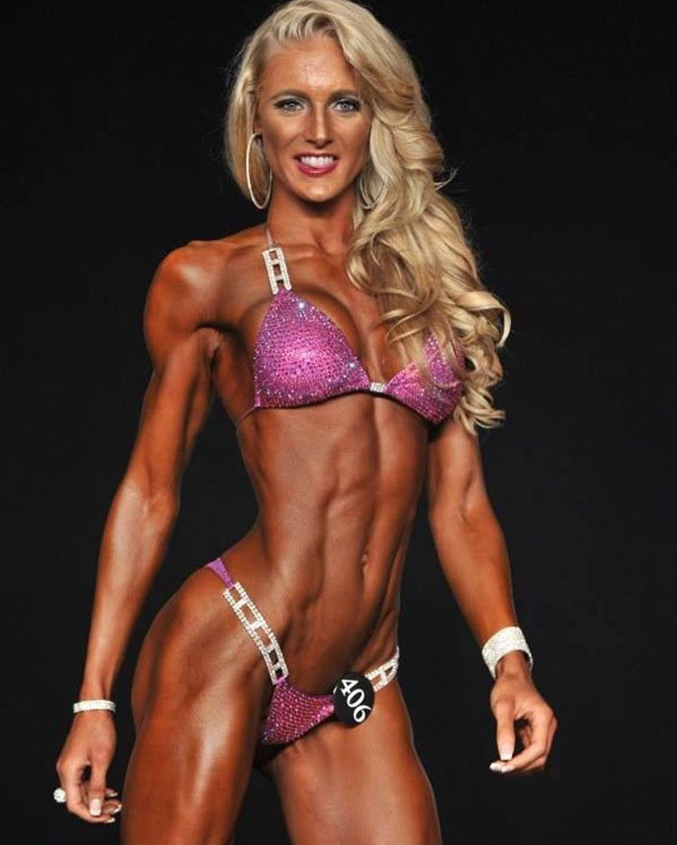 Katie Miller posing on the bodybuilding stage.