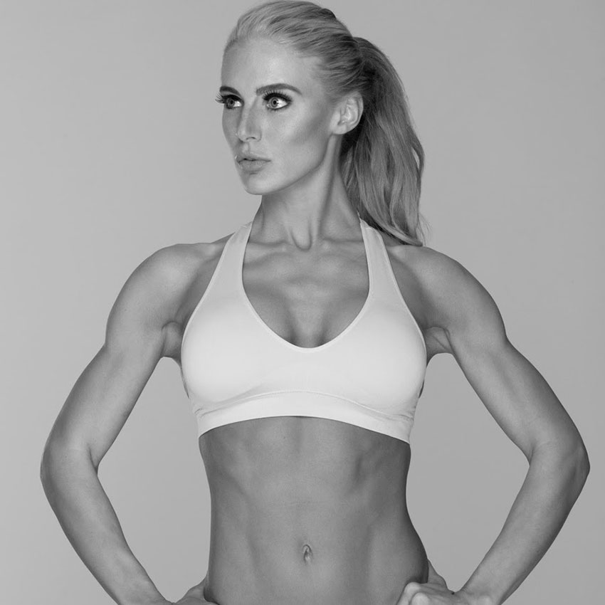 Katie Miller posing showing off her lean physique.