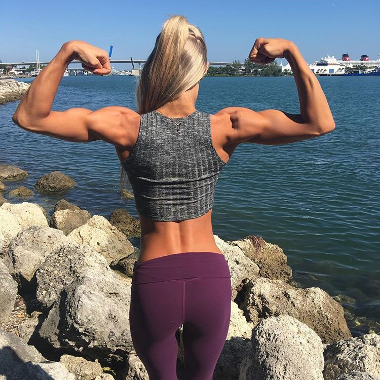 Katie Miller flexing her arms.