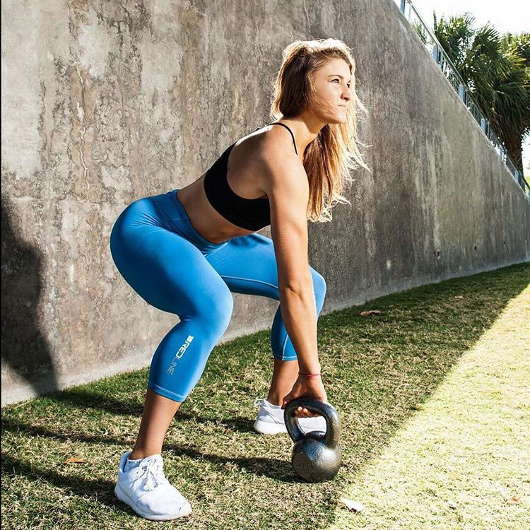 Katie Sonier exercising with a kettlebell.