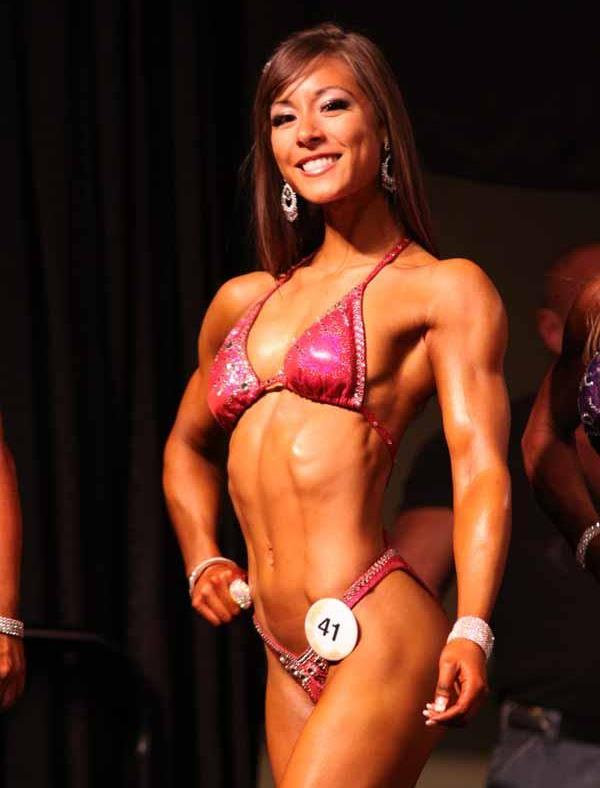 Kimberly Marie posing on the fitness stage