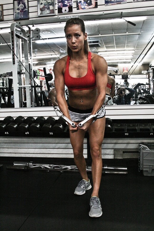 Kimberly Marie doing cable crossovers in the gym