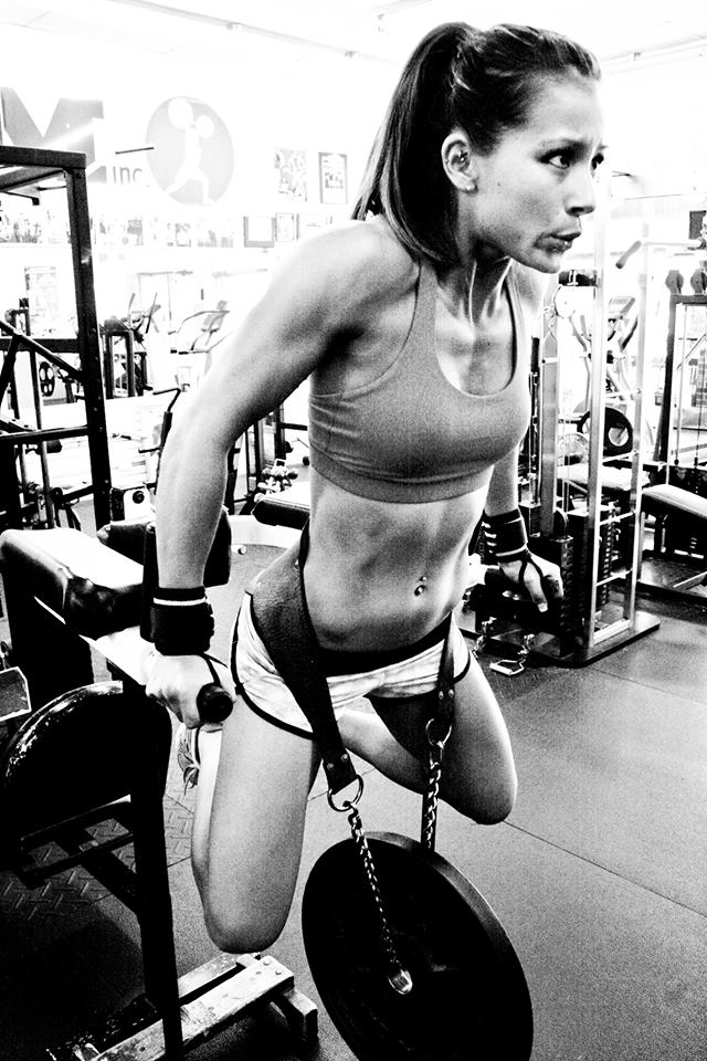 Kimberly Marie doing weighted dips in the gym