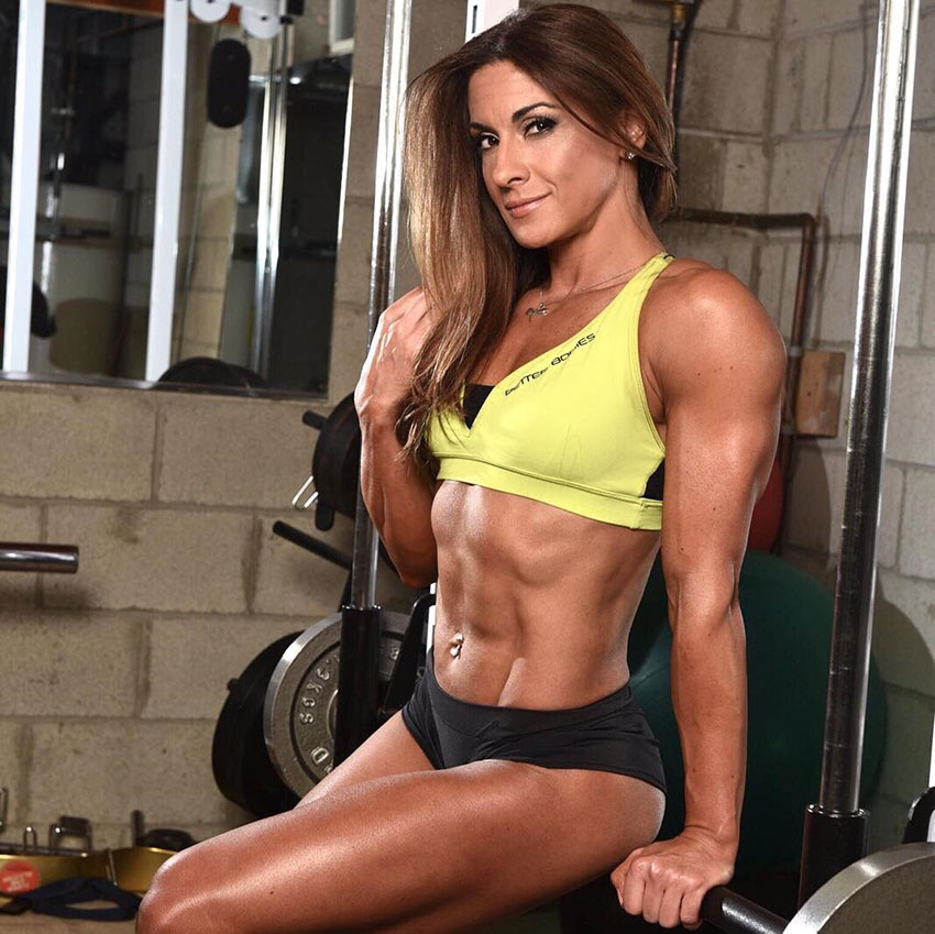 Maggie Corso posing in a photo shoot in the gym.