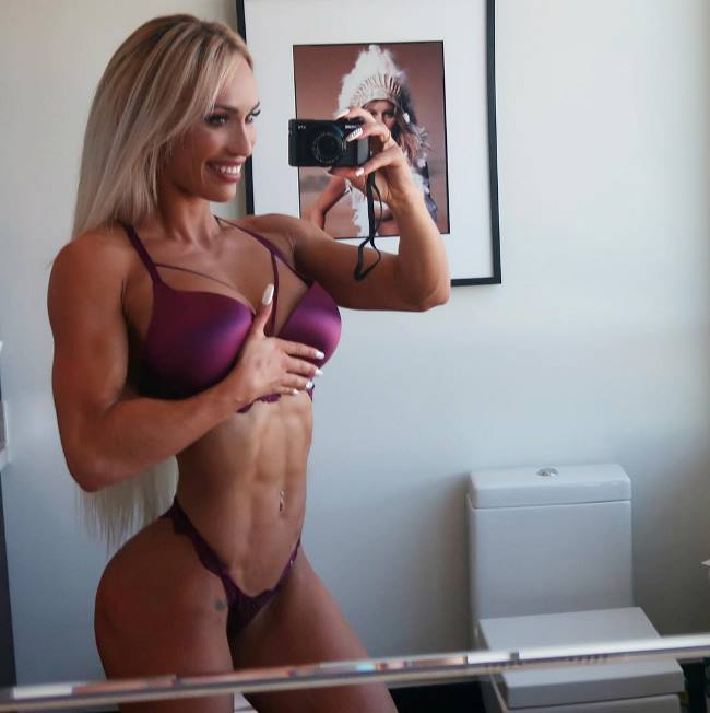Marialye Trottier taking a selfie of her ripped abdominals
