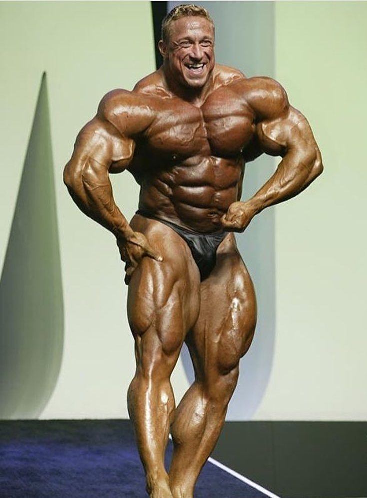 Markus Ruhl on the bodybuilding stage showcasting his impressively conditioned physique