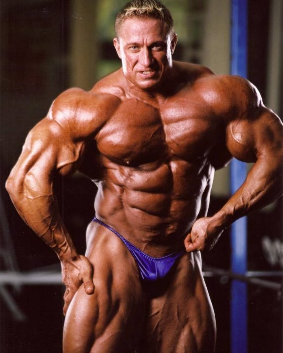 Markus Ruhl flexing his massive and ripped muscles for a photo shoot