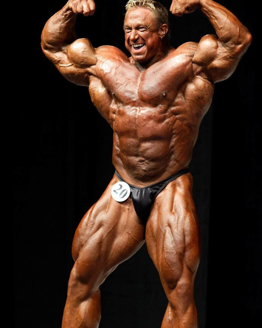 Markus Ruhl doing front double biceps pose on the bodybuilding stage