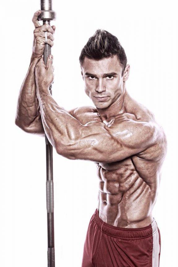 Matt Christianer holding a barbell in a photo shoot.