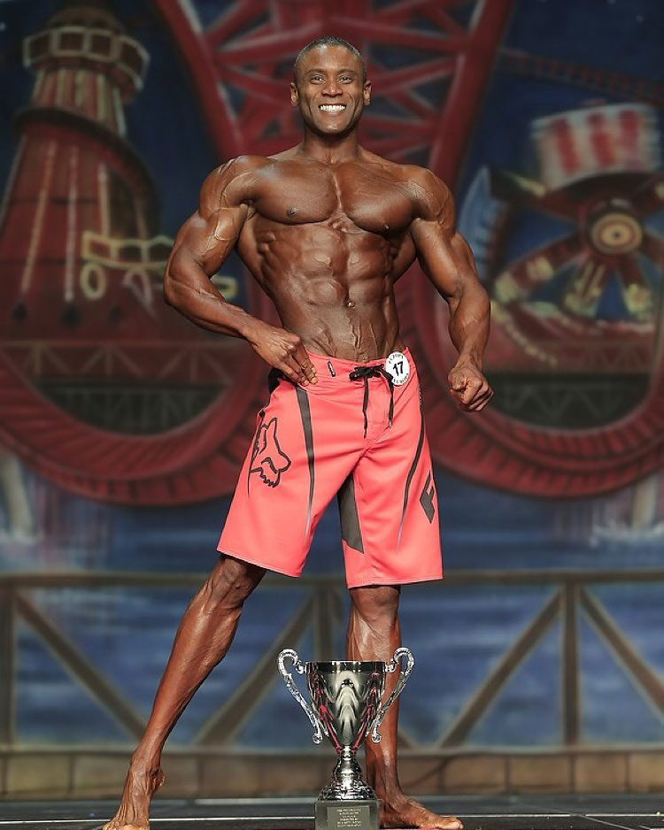 Michael Anderson posing on stage.