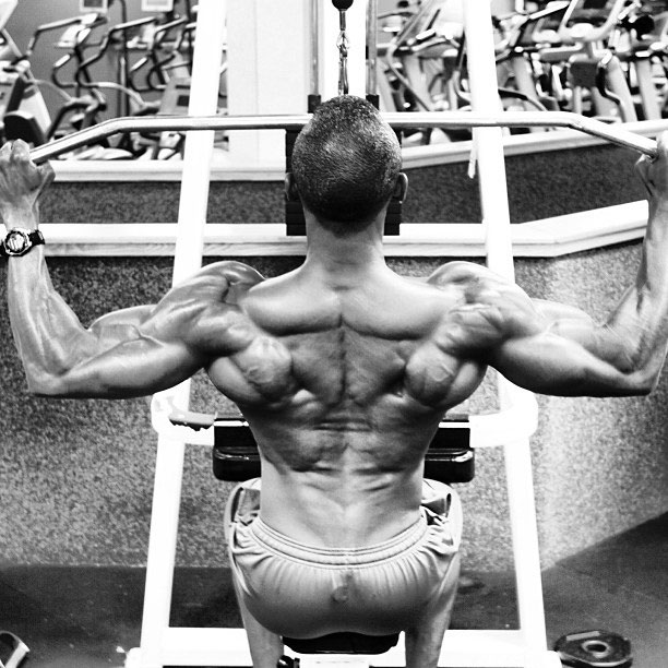 Michael Anderson performing lat pulldowns.