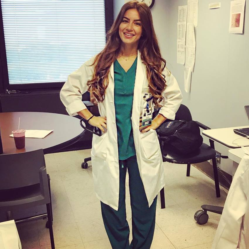 Mindy Sittinpretty in the doctor's uniform, looking healthy and happy